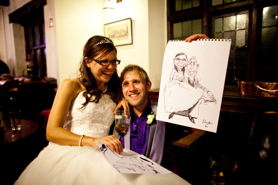 bride and groom with their live caricature drawing, shrewsbury wedding